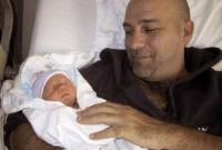 Kevin Gage with infant son Ryder - Jan 2007