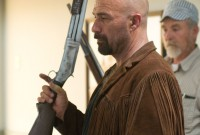 Kevin with weapons master (production still)